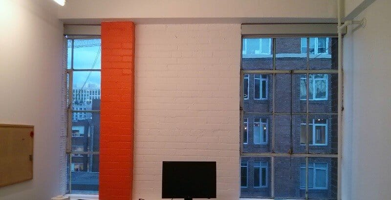 Off white with orange colour in the office
