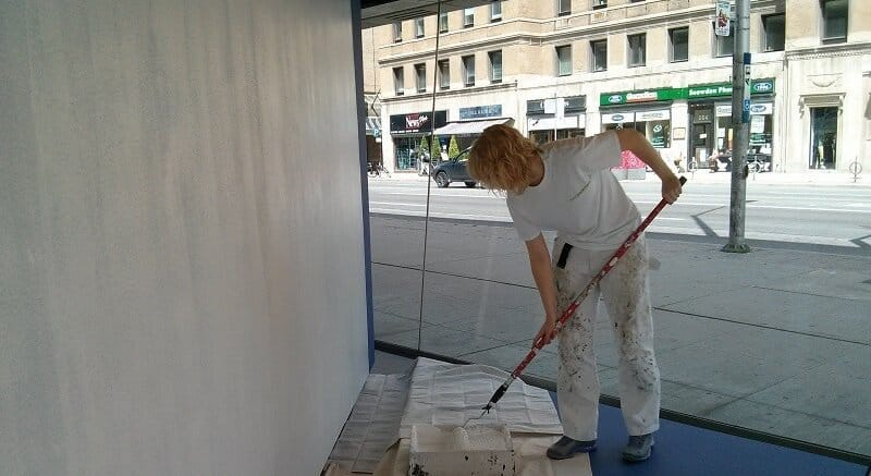 female painter in painter whites