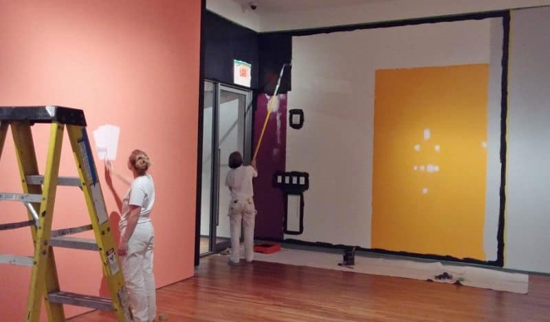 Painter is Painting walls in the Aga Khan Museum.