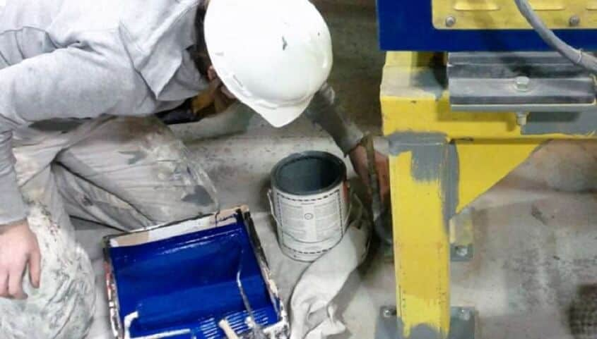 Painter using water based industrial enamel