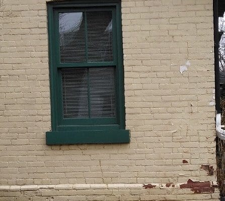 Deteriorating brick peeling paint