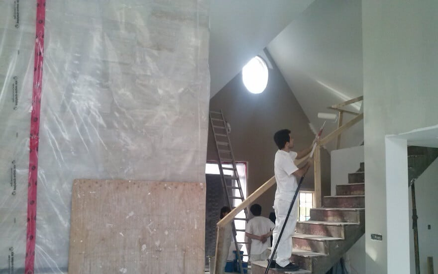 The painting crew starting work at this new home