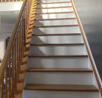 Stained staircase and white trim in home
