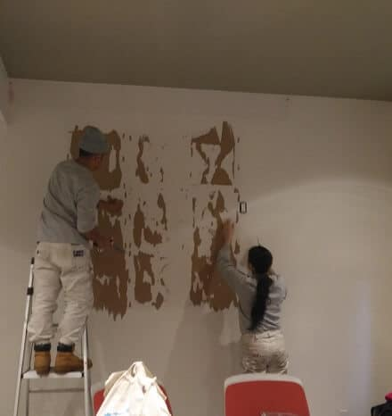 Painters prepping office walls